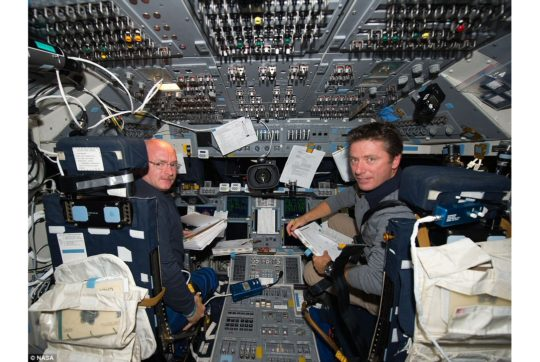 Commander Mark Kelly and Italian astronaut Roberto Vittori sit on Endeavour's flight deck during what was the Nasa vessel's final mission (c) NASA